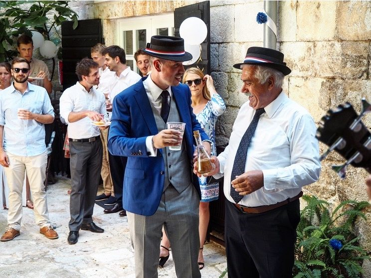 Groom and his dad drinking on wedding day
